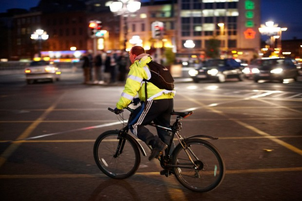 Man riding in a city wearing high visibility clothes