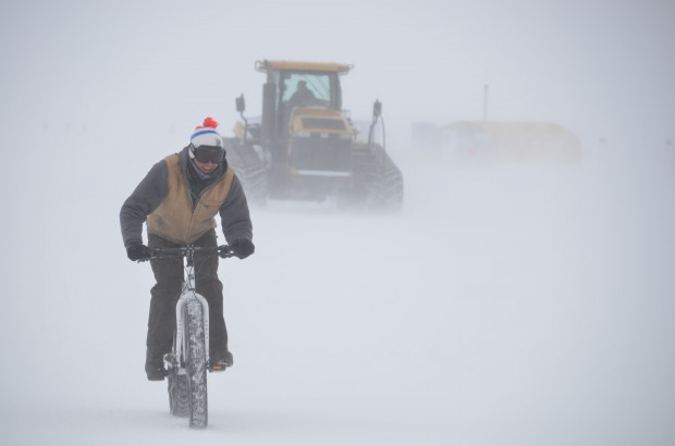 Man riding a Surly Pugsley at the South pole