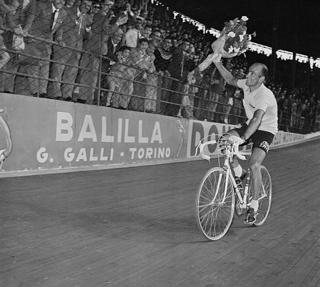 Italian Fiorenzo Magni is cheered on around Milan's Viggorelli Velodrome after winning the 38th Giro 1955.