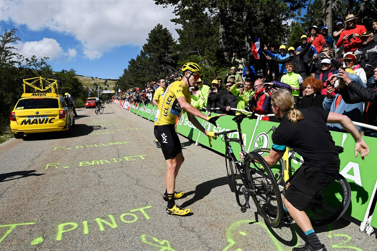 Christopher Froome is given a bicycle from the Team Sky support car after  crashing during the 12th stage of the 103rd edition of the Tour de France  cycling ... f9c6a3c8f